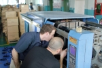 Pete and Kaspar inspect the injection molding machine
